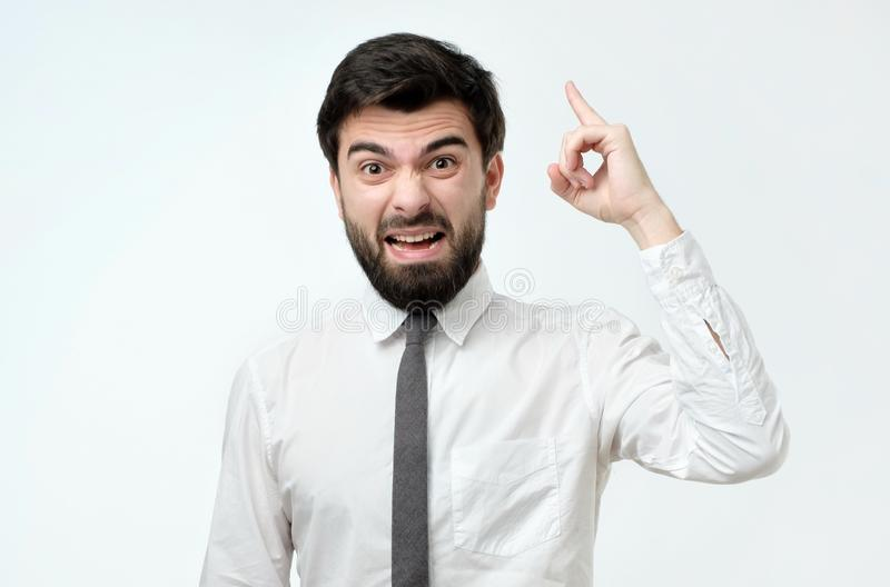 Angry man in ite and white shirt screaming stock photos
