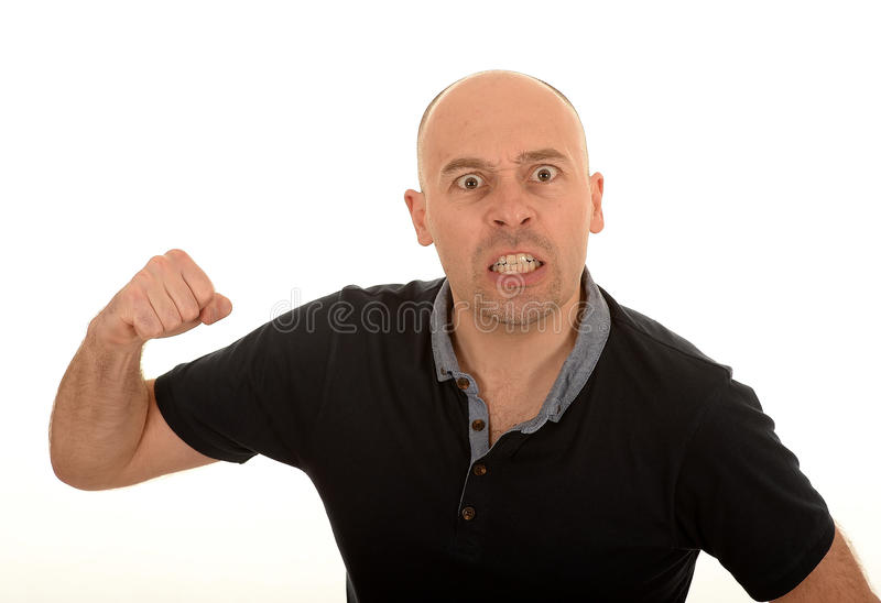 Angry man with raised fist royalty free stock image