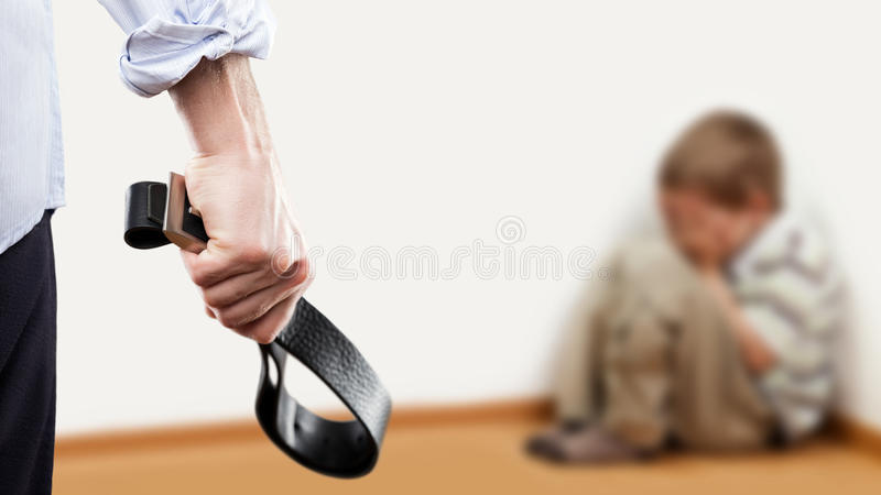 Angry man raised hand holding leather belt over wall corner sitt royalty free stock image