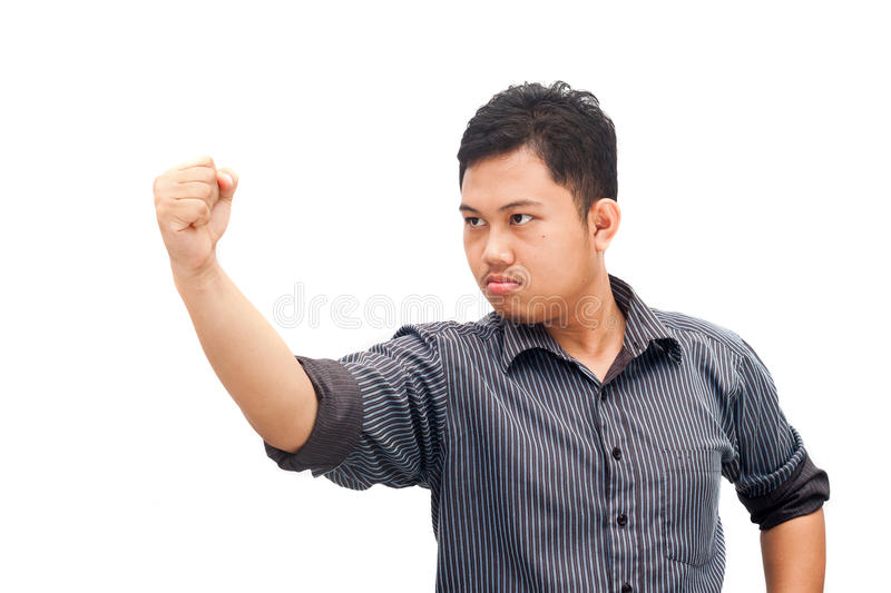 Angry man showing fist stock photo