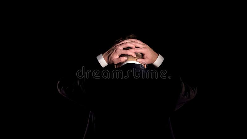 Angry man in suit holding head, regretting business crime, financial fraud royalty free stock photography