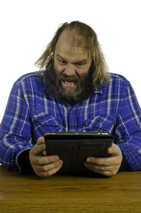 Download Angry man V Tablet stock photo. Image of plaid, computer - 24286574