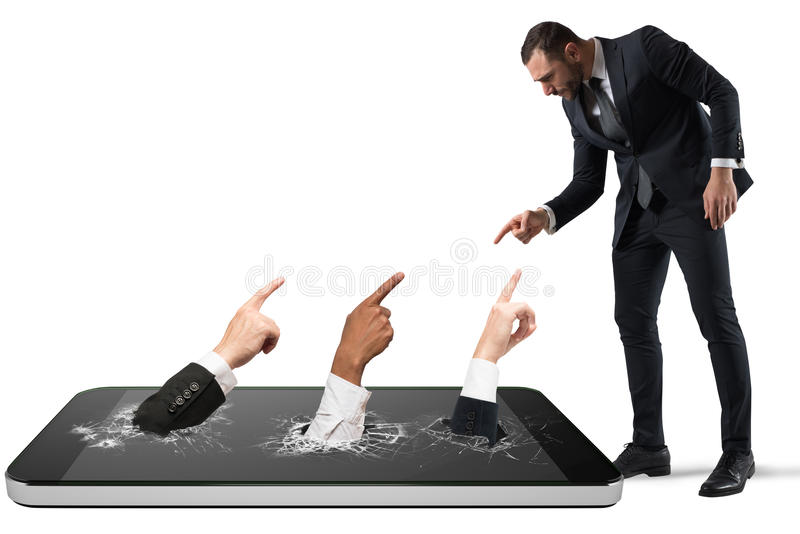 Angry man victim of cyber bullying with people that indicate him royalty free stock image
