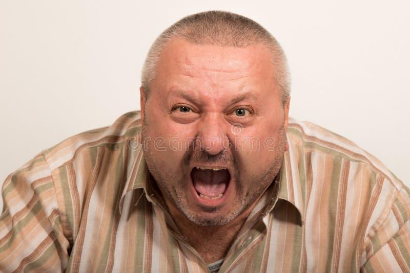 Angry man yelling. At the camera. Studio shoot stock image