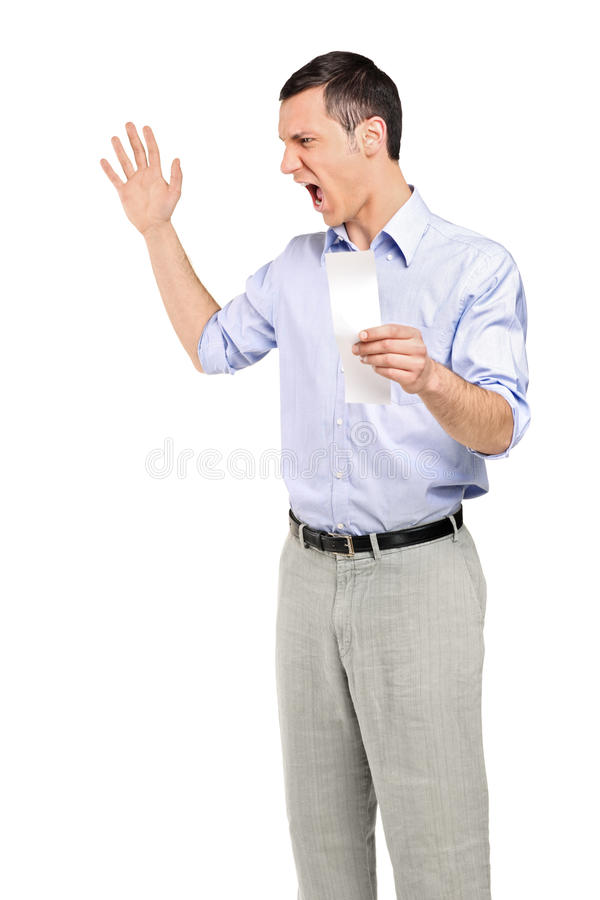 Angry man yelling after looking at store receipt royalty free stock photos