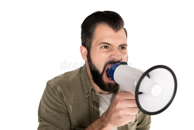 angry man yelling into megaphone, stock photo