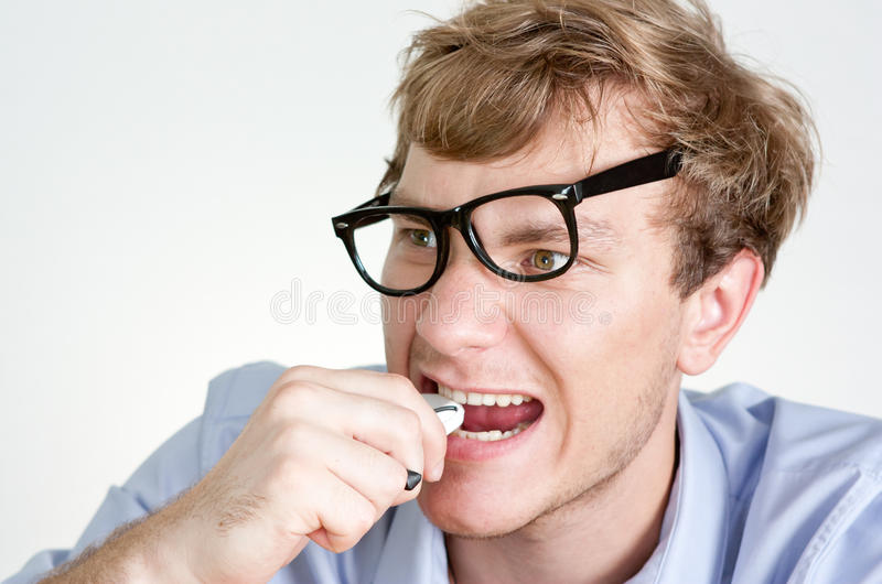 Angry Manager Eats Phone Stock Photos