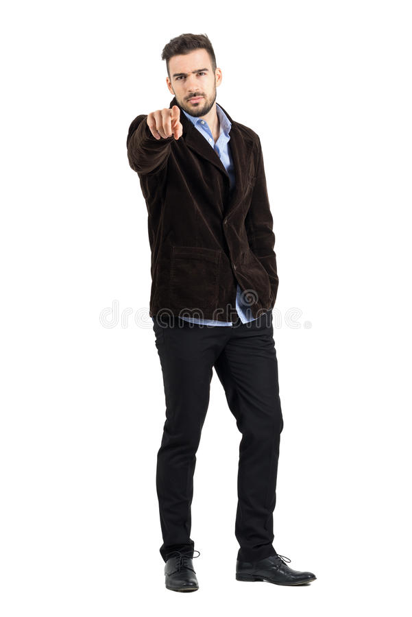 Angry manager pointing finger at camera accusing. Full body length portrait isolated over white studio background royalty free stock images
