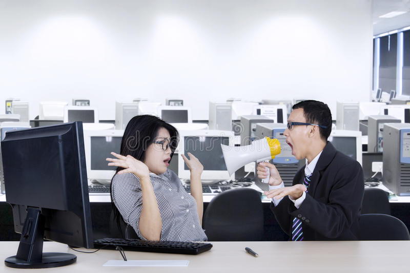 Angry manager with secretary in workplace royalty free stock image