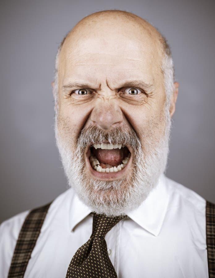 Angry mature man shouting at the camera royalty free stock image