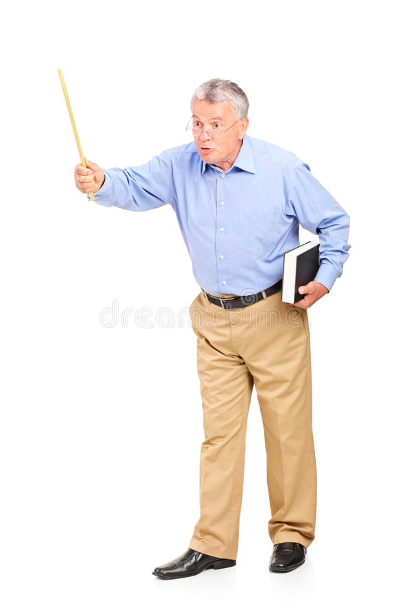 Angry mature teacher holding a wand and gesturing. Full length portrait of an angry mature teacher holding a wand and gesturing on white background stock image