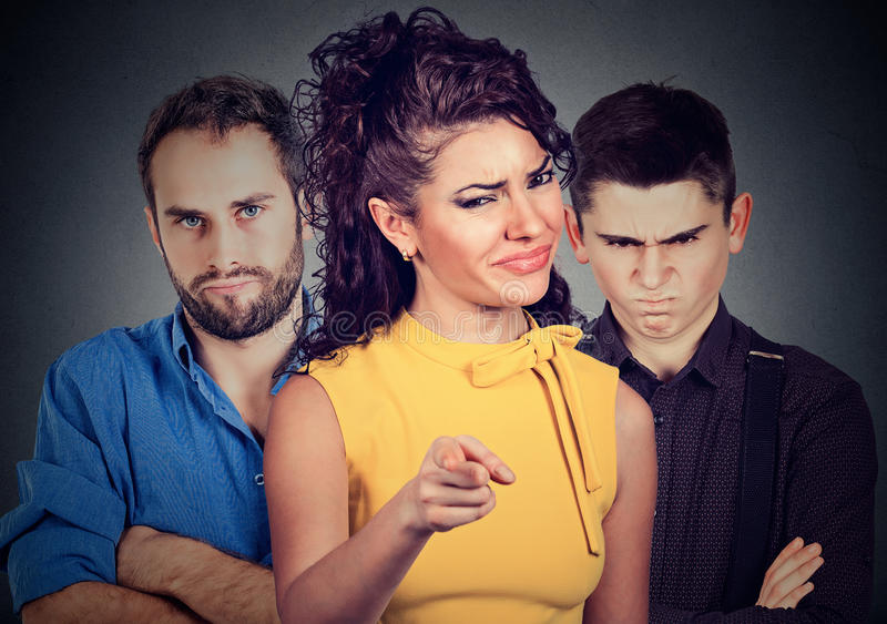 Angry mean people two men and a woman. Angry mean people blaming someone royalty free stock image