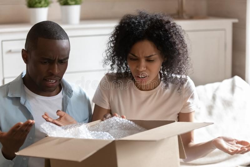 Angry millennial african american married spouse received damaged item. stock image
