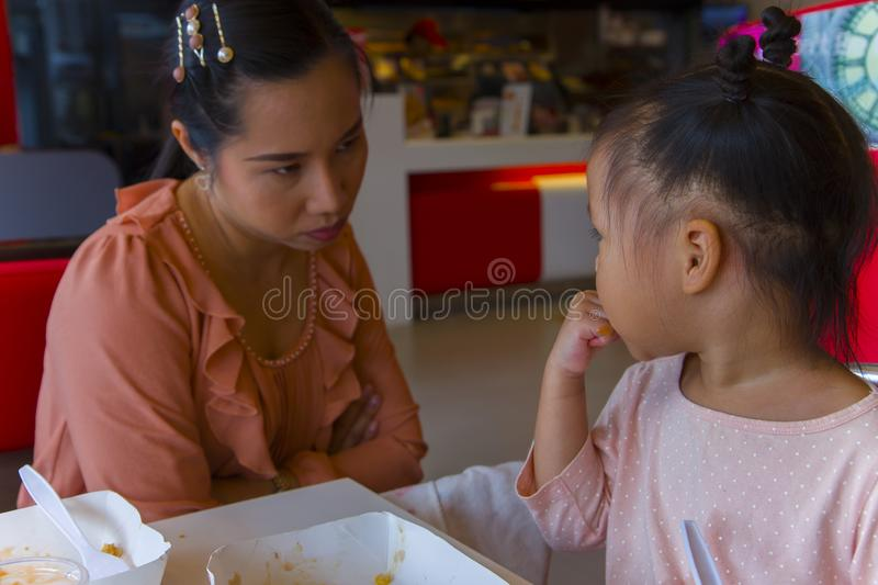 Angry mom with her child,  looking her daughter and complaining. High resolution image gallery royalty free stock images