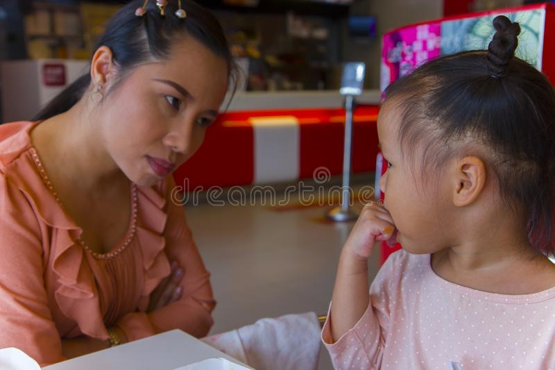 Angry mom with her child,  looking her daughter and complaining. High resolution image gallery stock photography