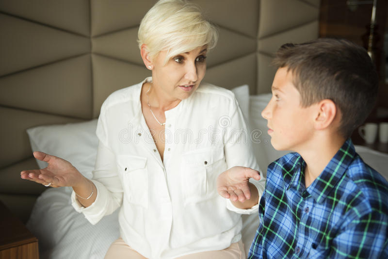 Angry mother explaining something to her teenager royalty free stock image