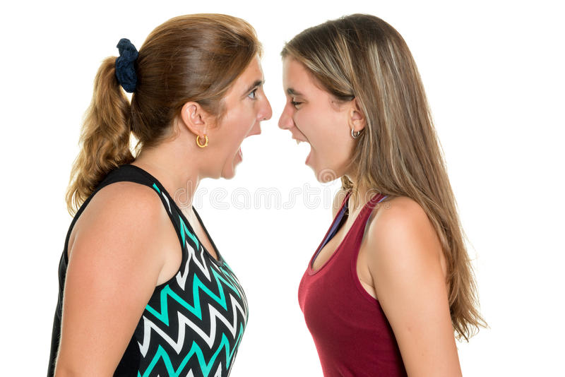 Angry mother and her teenage daughter yelling at each other. Isolated on a white background stock photography