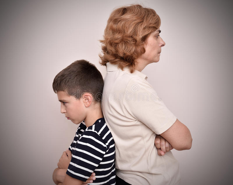 Angry mother and son stock images