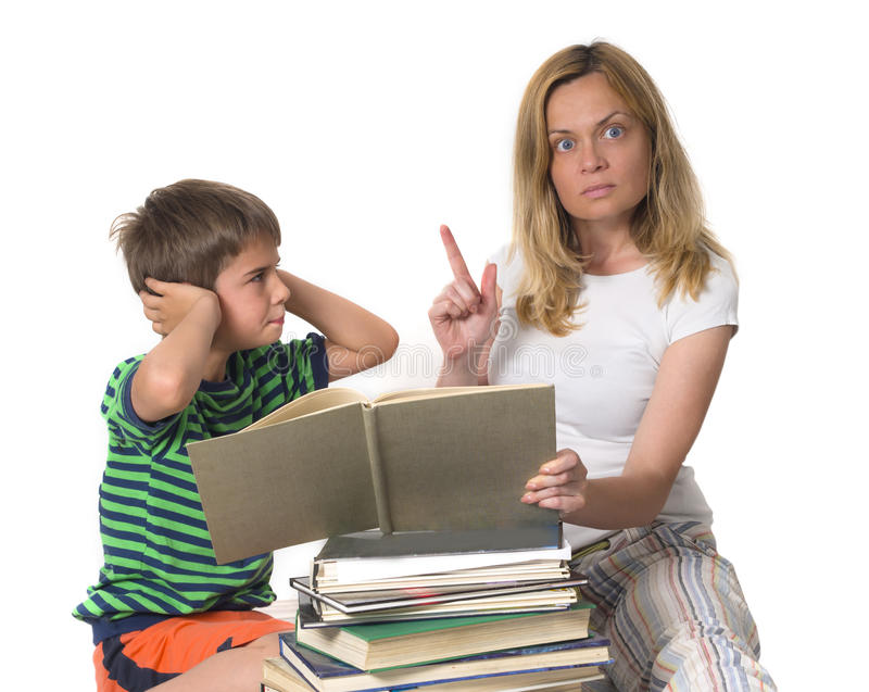 Angry mother trying to teach her son. While he is confronting, education concept, back to school royalty free stock images