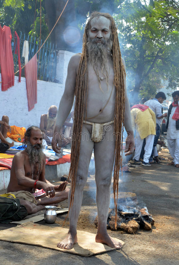 Angry Naga Sadhu or Nacked Monk. An angry Indian monk during the second day of their protest in Bhopal. They demand to scrap the bill proposing government stock images