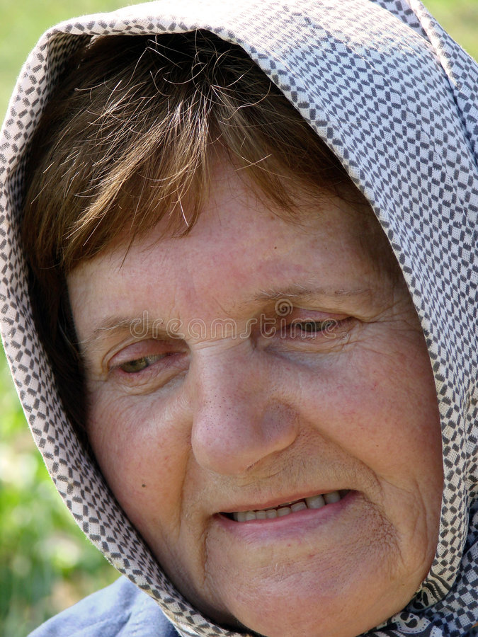 Angry old woman with scarf stock images
