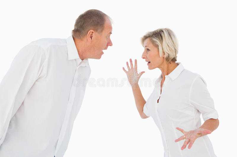 Angry older couple arguing with each other. On white background stock photos