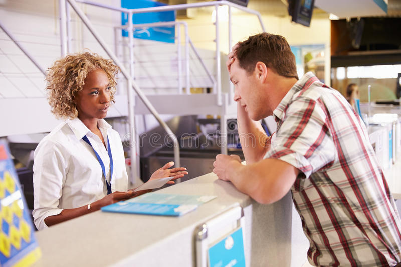 Angry Passenger Complaining To Staff At Airport Check In royalty free stock photo