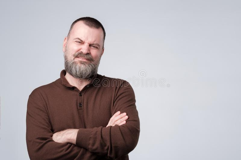 Angry, pissed off mature man with arms crossed folded. royalty free stock images