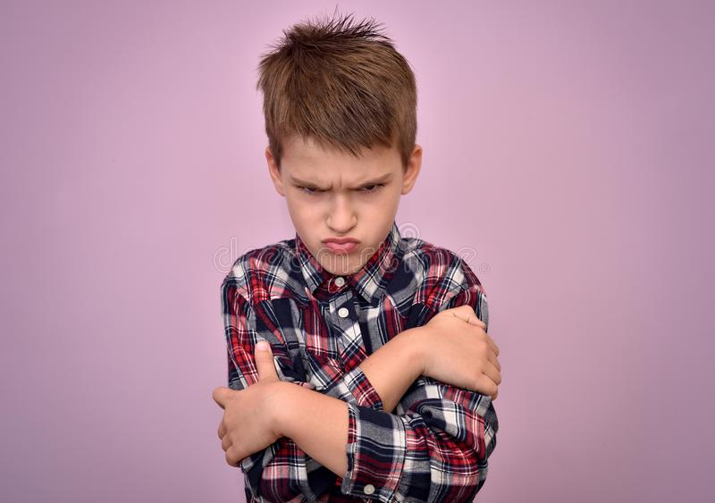 Angry and pouting young boy stock photos