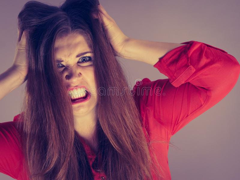 Angry young pretty woman. Angry pretty attractive woman being pissed off. Very frustrated lady having brown hair stock photography