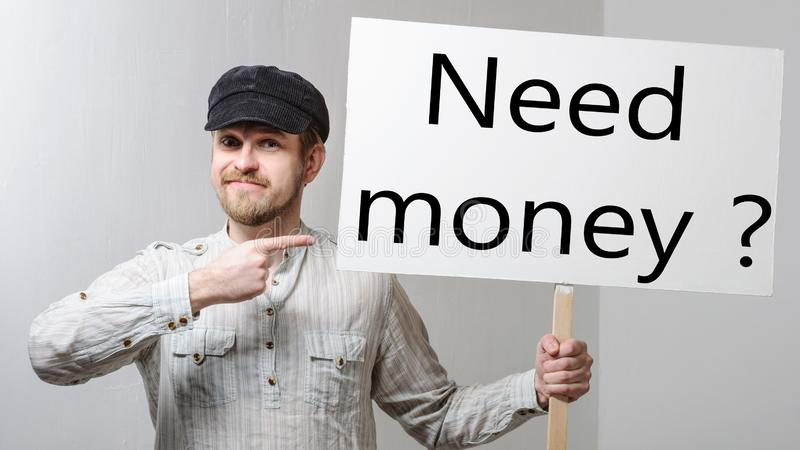 Angry protesting worker with protest sign inscription need money.  stock photo