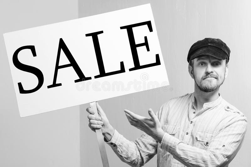 Angry protesting worker with protest sign inscription sale.  stock photos