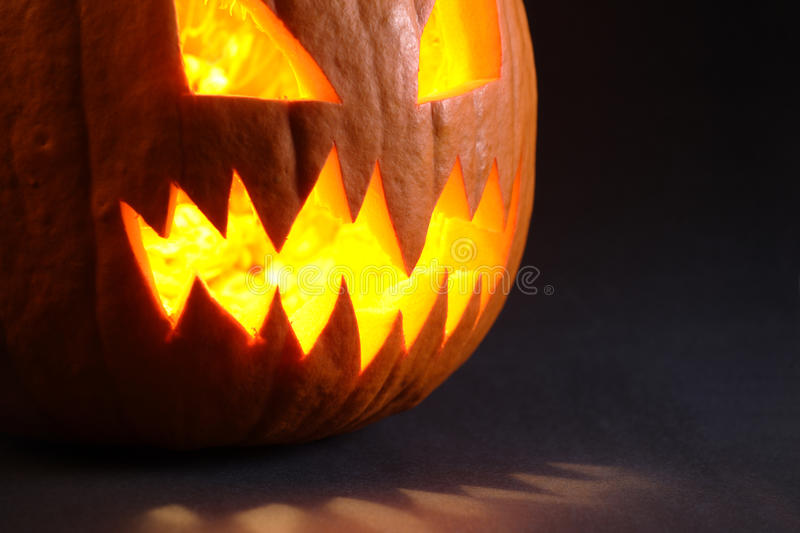 Angry pumpkin with big teeth. Photo of an angry pumpkin illuminated by a candle inside royalty free stock image