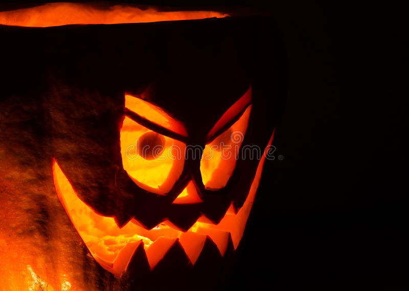 The angry pumpkin. An angry pumpkin, candle lighted stock photos