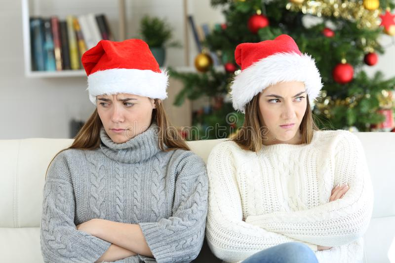 Angry roommates or sisters in christmas royalty free stock images
