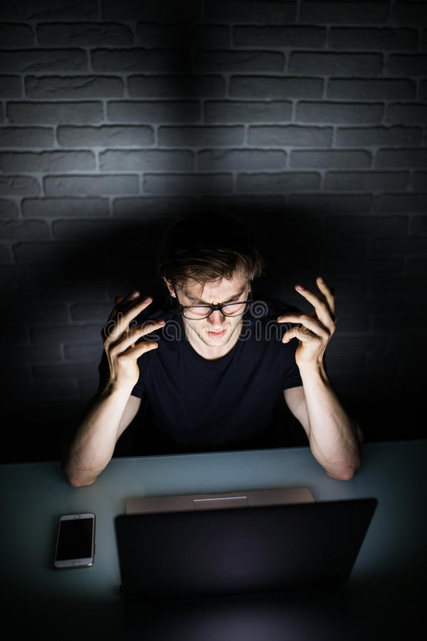 Angry sad businessman workaholic working late at home stock photo