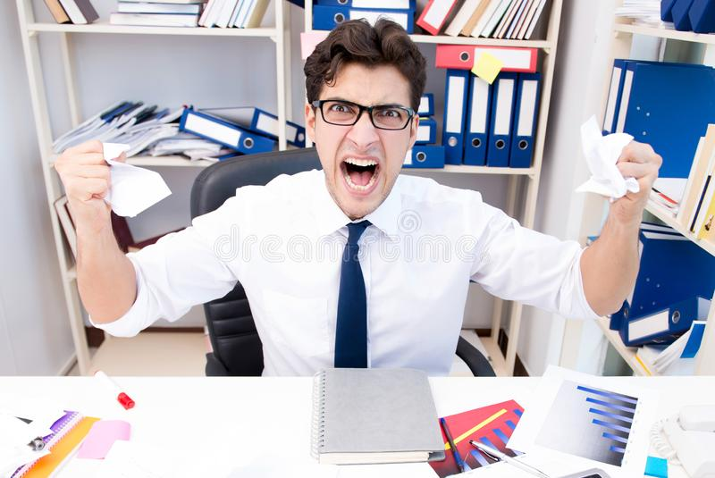 Angry and scary businessman in the office. The angry and scary businessman in the office stock image
