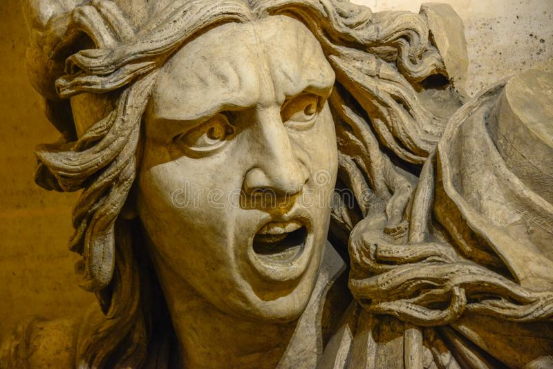 Angry screaming man face statue stock photos