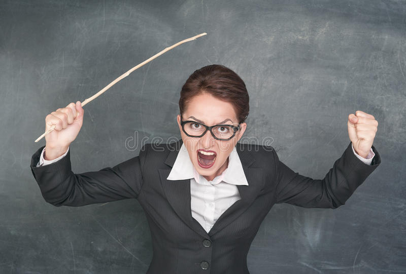 Angry screaming teacher. With wooden stick stock image