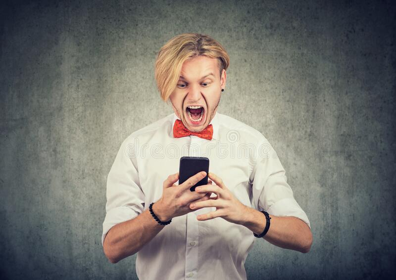 Angry screaming man with a smart phone royalty free stock photo
