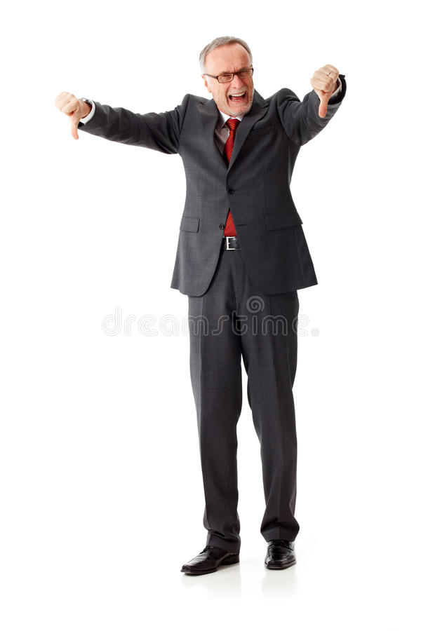 Angry senior business man with thumbs down stock photo