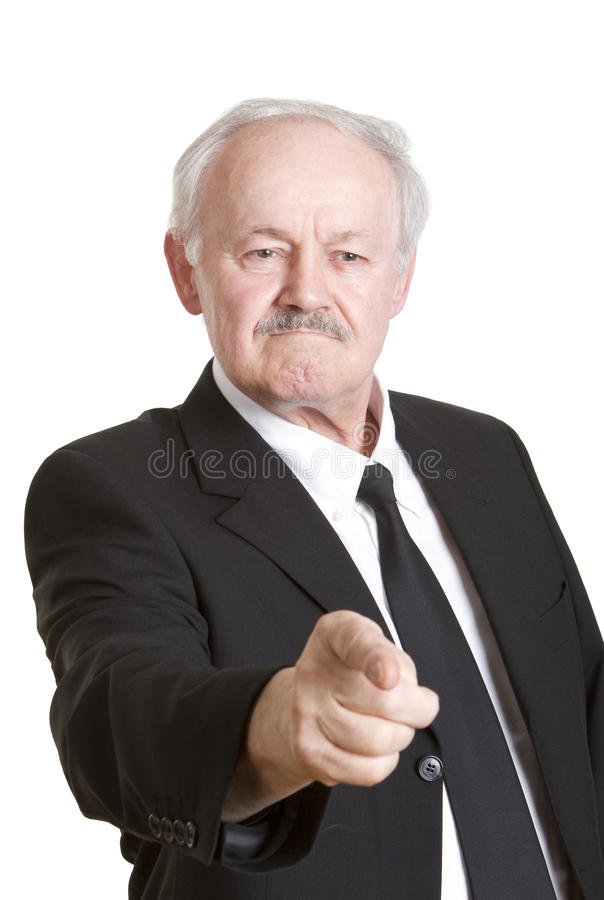 Angry senior businessman giving orders. Angry senior businessman pointing with his finger and giving out orders, isolated on white royalty free stock photo
