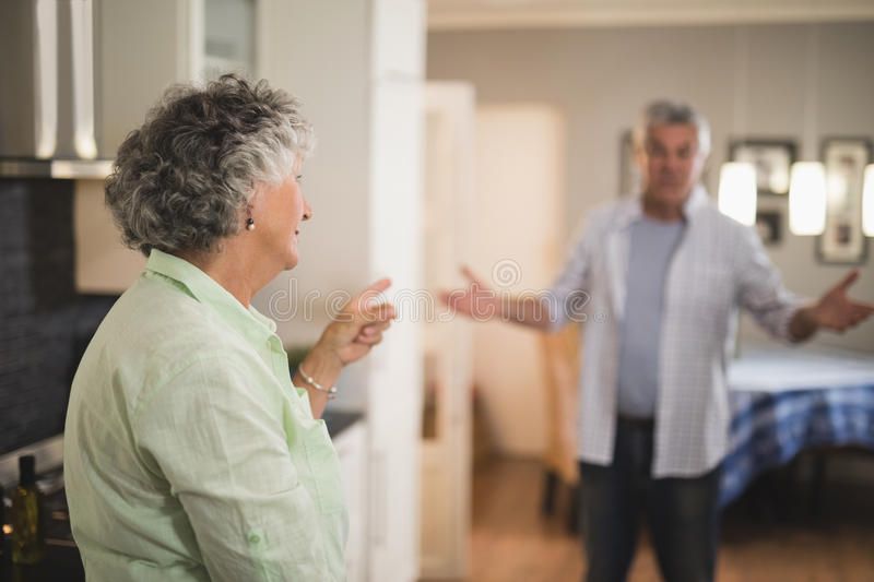Angry senior couple talking at home royalty free stock photos