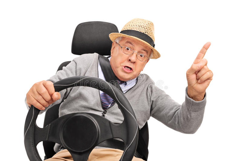 Angry senior holding a steering wheel and cursing. And gesturing with his finger isolated on white background stock images