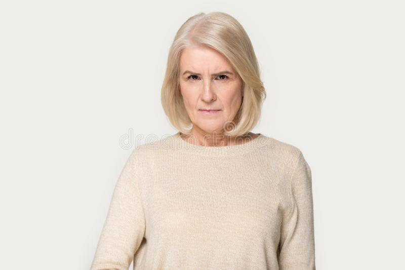 Mad senior woman feel dissatisfied look angrily at camera royalty free stock images