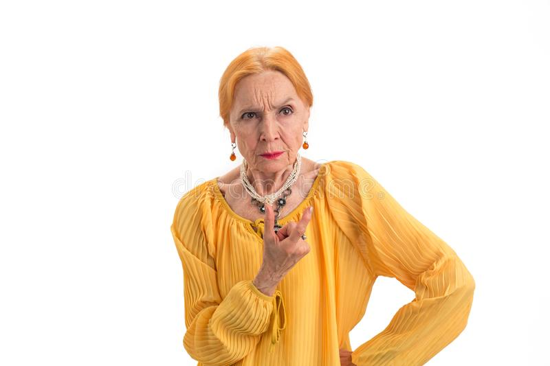 Angry senior woman isolated. royalty free stock photography