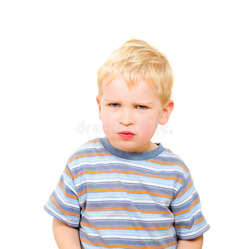 Angry and serious beautiful boy isolated on white royalty free stock photos