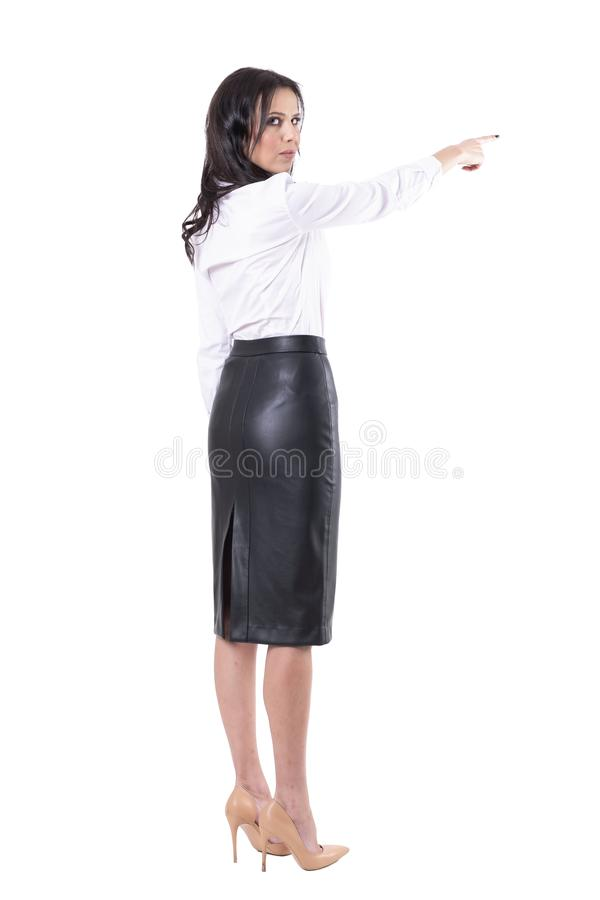 Angry serious strict authoritative teacher or business woman boss with get lost finger gesture. Full body isolated on white background royalty free stock photography