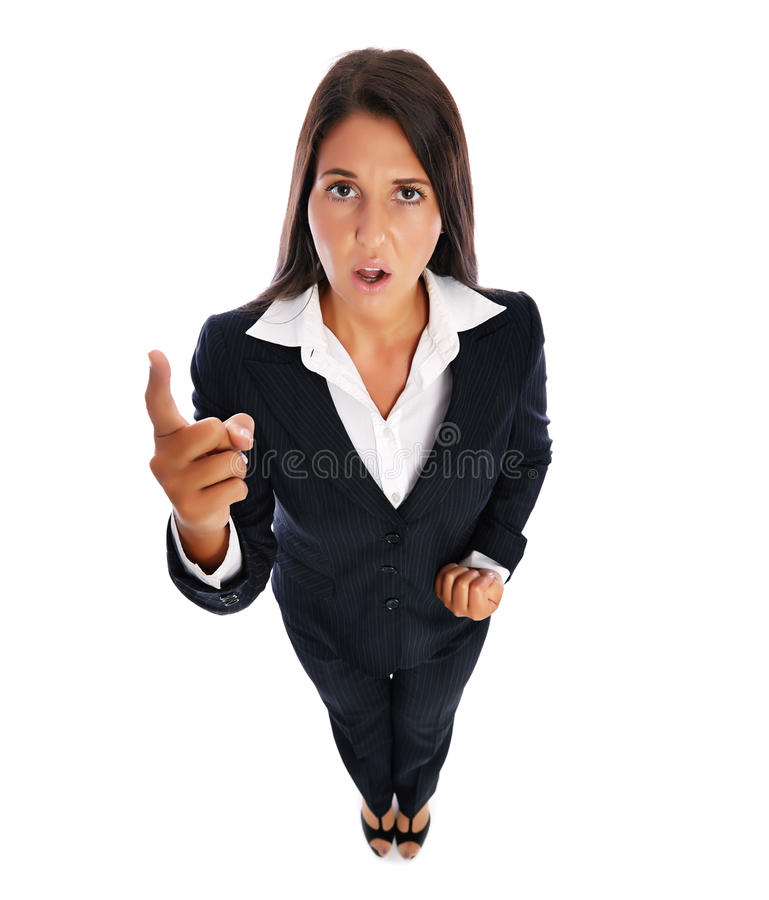 Angry shouting business woman. Business woman shouting and pointing at the camera. Isolated on a white background royalty free stock image