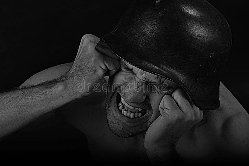 Angry soldier - dramatic. Angry soldier with closed eyes screaming. Artistic black and white portrait